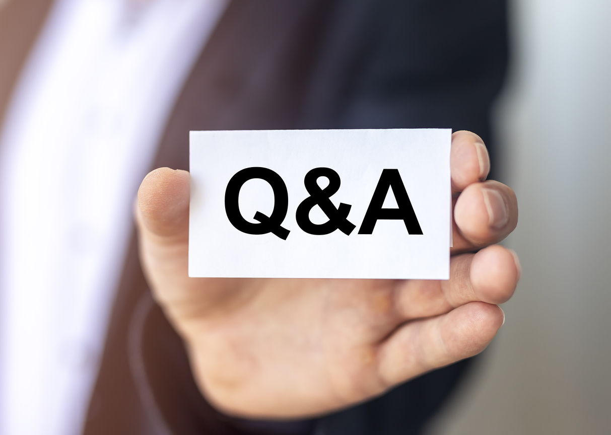 Image showing a hand holding a card with Q&A on it